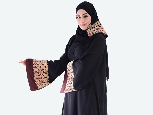 Traditional Abaya made from durable crepe fabric with laser print designs on front and back