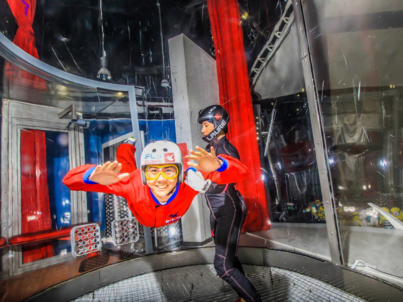A young man and instructor at iFly Dubai in City Centre Mirdif