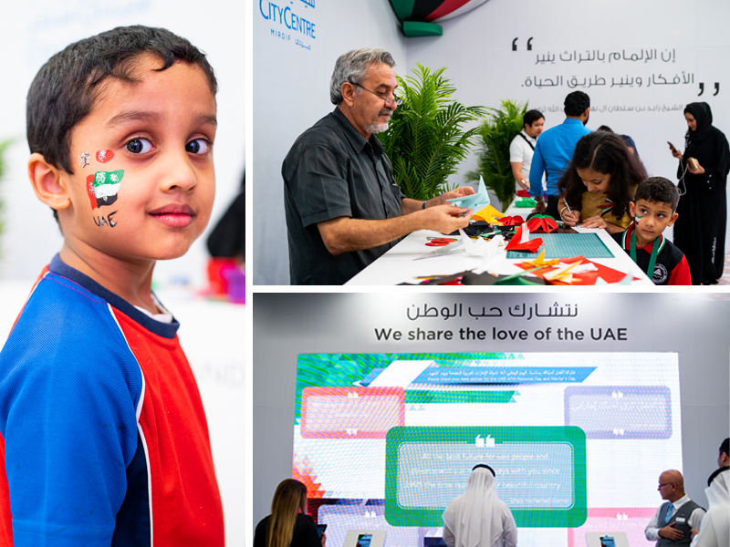Young boy with painted UAE flag on his face, origami station and tech station at City Centre Mirdif