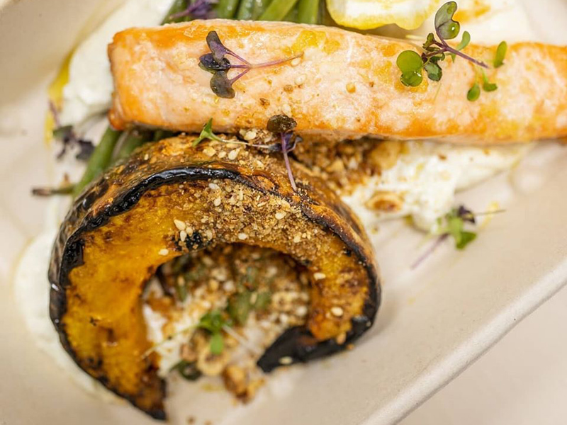 The Grilled Salmon dish, served with pumpkin, from Toplum, City Centre Mirdif